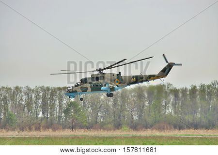 Vasilkov Ukraine - April 24 2012: Ukrainian Air Force Mi-24 attack helicopter is landing on the runway of the airfield