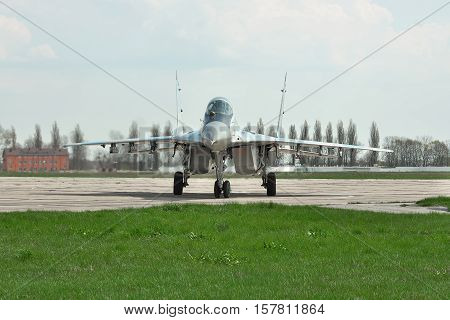 Vasilkov Ukraine - April 24 2012: Ukraine Air Force MiG-29 is taxiing to the runway for takeoff into another training flight