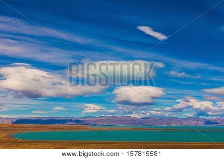 Plain with shallow emerald lake. Argentine Patagonia on a windy day
