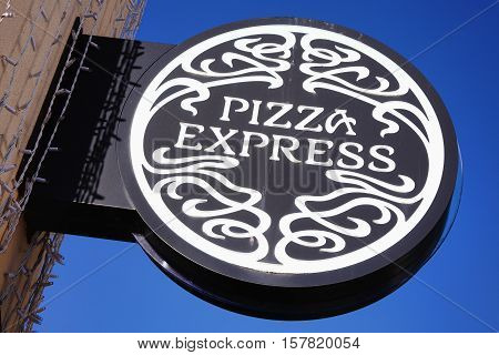 Carmarthen, Wales, UK, October 22, 2016 :  PizzaExpress logo advertising sign outside its restaurant in St Catherine's Walk