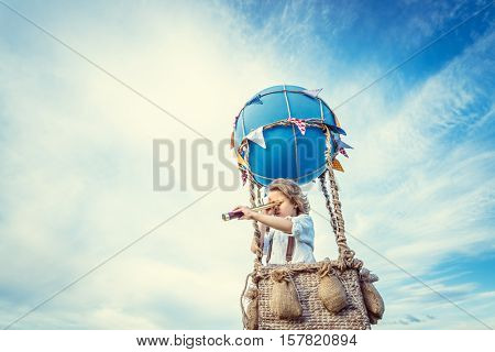 Little boy with spyglass outdoors