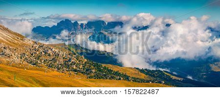 Foggy Sunny Panorama Of The Val Gardena Valley