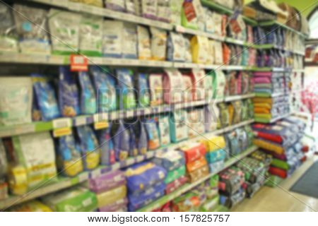 Packs of animal food on pet shop shelves