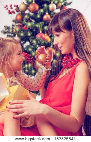 mother with little girl on christmas