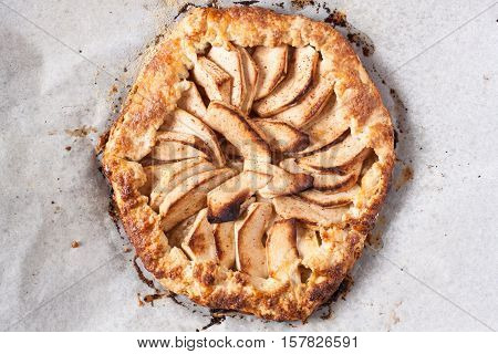 homemade fresh apple galette, apple tart on parchment paper