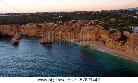 Aerial from famous beach Praia da Marinha in the Algarve Portugal at sunset