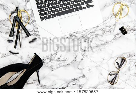Notebook supplies feminine accessories on marble office desk background. Fashion flat lay for blogger social media poster