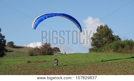 ROCCA PRIORA ITALY - NOVEMBER 1 2016: paragliding lesson a paraglider landing after a training flight