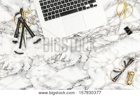 Notebook supplies feminine accessories on bright marble office desk background. Fashion flat lay for blogger social media