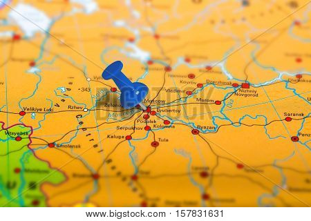 Moscow in Russia pinned on colorful political map of Europe. Geopolitical school atlas. Tilt shift effect.