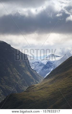 Beautiful vista through mountain valley onto with snow and glaciers covered Scandes mountain range