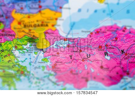 Troy Truva historical town in Turkey pinned on colorful political map of Europe. Geopolitical school atlas. Tilt shift effect.
