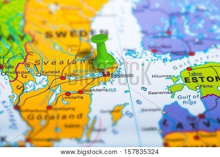Stockholm in Sweden pinned on colorful political map of Europe. Geopolitical school atlas. Tilt shift effect.