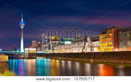 Colorful Night Scene Of Rhein River At Night In Dusseldorf.