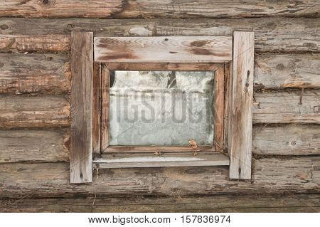 glass window of a old wooden house