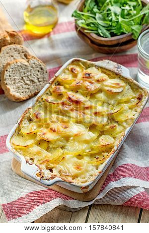 Potato gratin with bacon and cheese on top