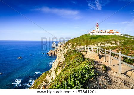 Cabo da Roca Portugal. Lighthouse and cliffs over Atlantic Ocean the most westerly point of the European mainland.