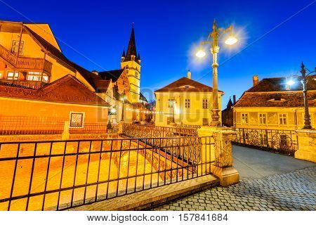 Sibiu Romania. Evangelical Cathedral and the Liars Bridge in the center of Sibiu Transylvania European Capital of Culture for the year 2007.