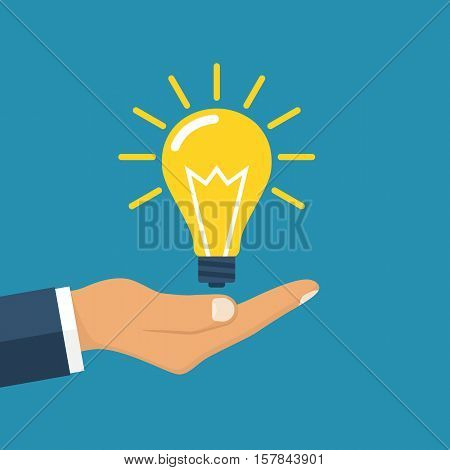 Abstract conceptual vector illustration in flat style design. Hand holding business idea. Electrical lamp in hand as a symbol of creative solutions. Give idea. Isolated on background.