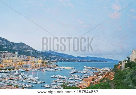The numerous yachts and boats in Hercules Port of Monaco especially beautiful place in the evening.