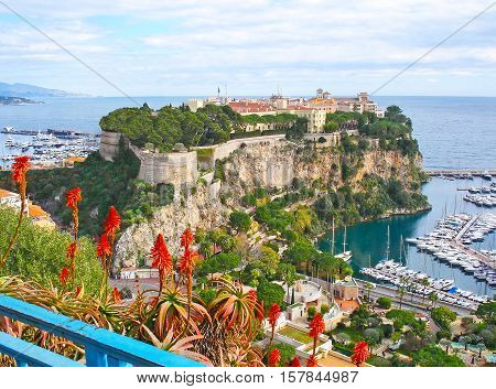 The Rock of Monaco located between two ports at Mediterranean coast it's occupied with the oldest city ward - Monaco-Ville surrounded by citadel walls.