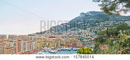 Panorama of the Fontvieille ward with colorful residential buildings and the new harbor at the mountain foot Monaco.