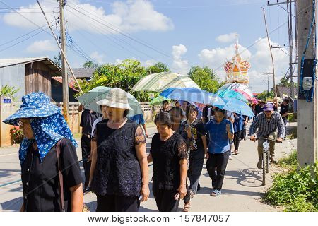 CHIANG RAI THAILAND - NOVEMBER 19 : unidentified Thai people walking to the graveyard on November 19 2016 in Chiang rai Thailand
