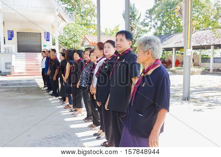 CHIANG RAI THAILAND - NOVEMBER 19 : unidentified Thai civil boy scout in line standing saluting for dead man in a funeral on November 19 2016 in Chiang rai Thailand