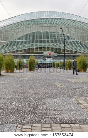LIEGE BELGIUM - December 2014: Travellers on the square in front of the Liege-Guillemins railway station designed by Santiago Calatrava.
