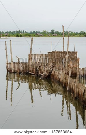 Traditional reed fishing traps used in wetlands near the coast in Benin. These walls lead the fish into narrow traps where they can be collected.