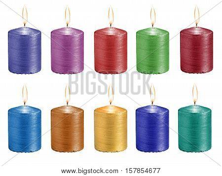 set multicolored celebratory burning candles isolated on white background