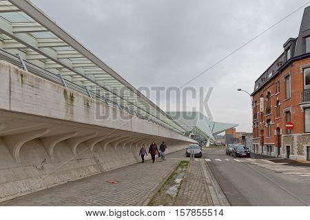 LIEGE BELGIUM - December 2014: Traveller walking in front of the Liege-Guillemins railway station designed by Santiago Calatrava.
