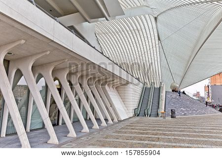 LIEGE BELGIUM - December 2014: Travellers on the steps in front of the Liege-Guillemins railway station designed by Santiago Calatrava.