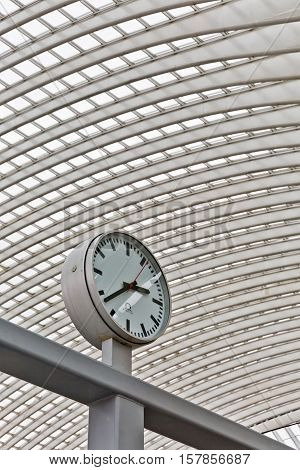 LIEGE BELGIUM - December 2014: Abstract view on the roof with station clock of the Liege-Guillemins railway station designed by Santiago Calatrava.