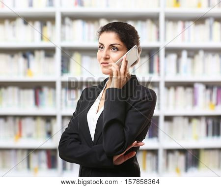 Woman talking on phone on bookshelves background. Law and justice concept.