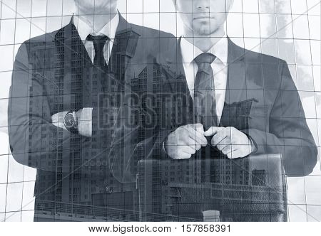 Double exposure of men and building background. Business concept. Black and white photo.