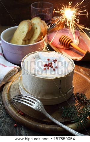 New Year food: French Vacherin Mont d'Or cheese cold cuts and red wine