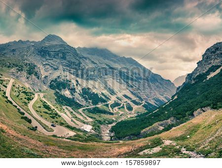 View from the top of famous Italian Stelvio High Alpine Road elevation of 2757 m above sea level. Stelvio Pass South Tyrol province of Sondrio Ortler Alps Italy Europe. Retro style.