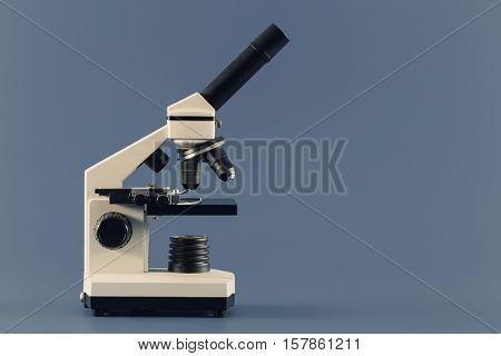 monocular microscope on blue background