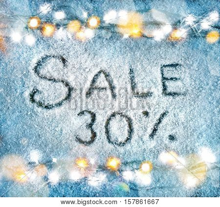 Sale 30 percent off. Christmas snowy background with garland. Top View. Merry Christmas and Happy New Year discount!!