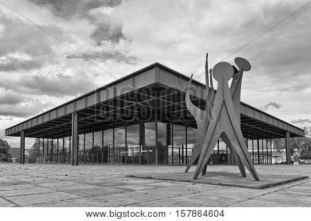 BERLIN GERMANY - JULY 2015: Exterior view of The Neue Nationalgalerie art gallery is a masterpiece of modern architecture designed by Mies Van Der Rohe in 1968 as part of the Kulturforum. Black and white photograph