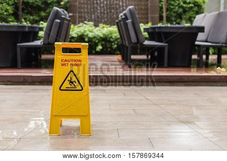 Wet Floor Warning Sign On The Floor In Hotel Corridor