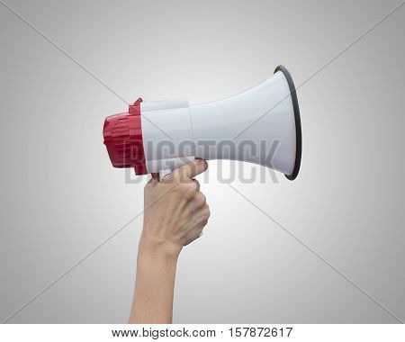 Hand Holding White Megaphone Isolated On Grey Background. Saved With Clipping Path