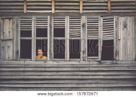 PHUKET THAILAND - OCTOBER 1 : The unidentified people standing at window in the old wood house in Phuket old town while renovation in Phuket on October 1 2016.