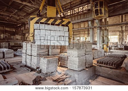 Stack of precast reinforced concrete slabs in a house-building factory