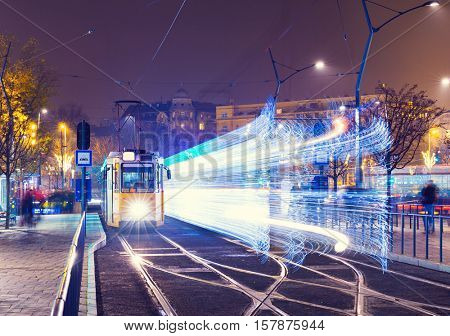 Old Tram At Train Central Station And Speed Motion Abstract Light At Night In Budapest, Hungary.
