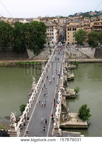 ROME, ITALY - JUNE 12, 2015: People on the bridge of Sant'Angelo in Rome Italy