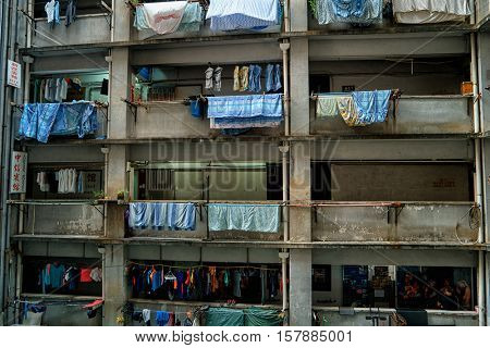 Hong Kong - October 2016: Typical residential building with porch and hanging laundry . Kowloon
