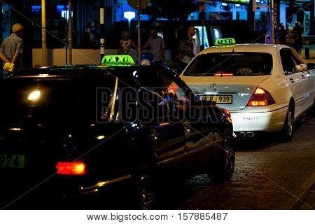 PROTARAS, CYPRUS - 10 OCT 2016: Taxi car on the street of Protaras at night
