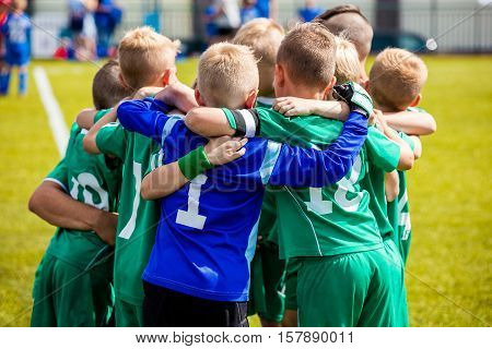 Young football soccer players in sportswear. Young sports team with football coach. Pep talk with coach before the final match. Soccer school tournament poster